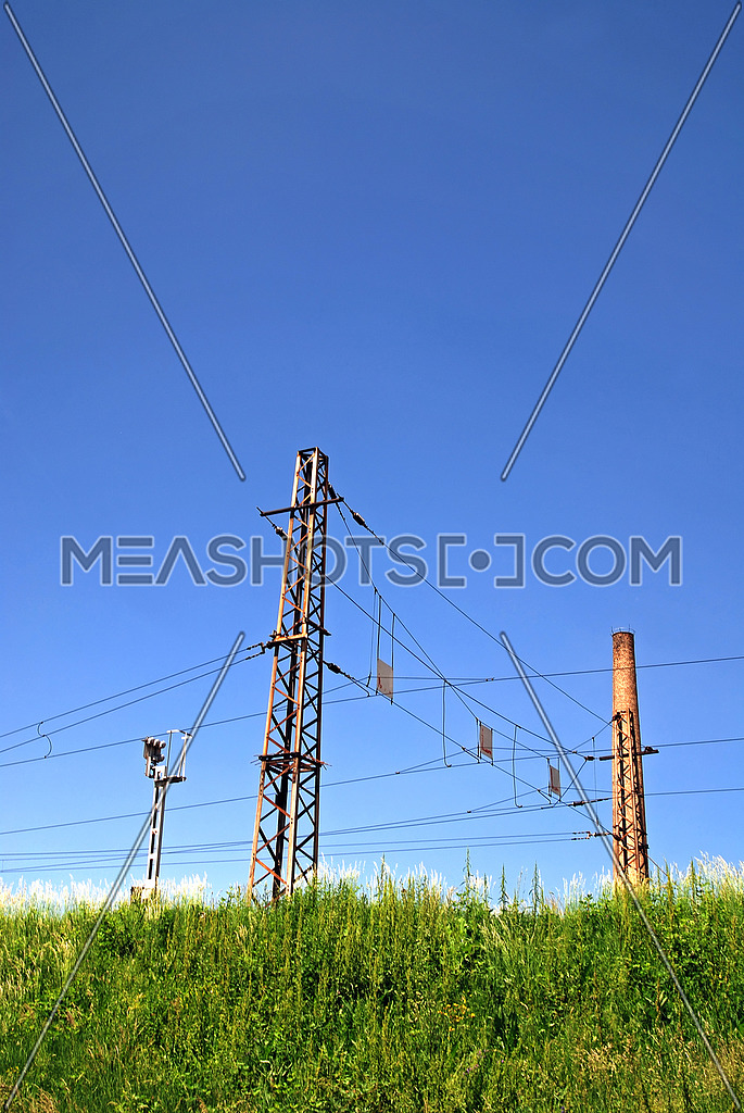 Electric power cable line crossing green nature landscape