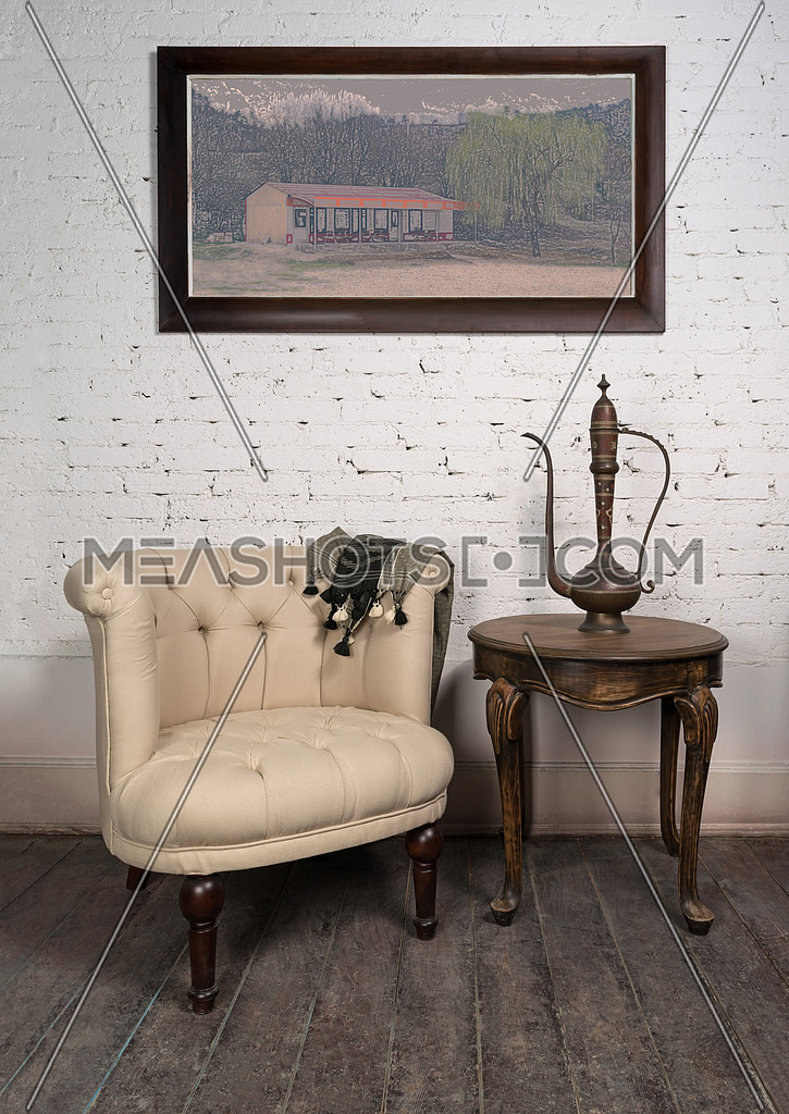Old beige armchair, brass teapot, framed painting and antique t