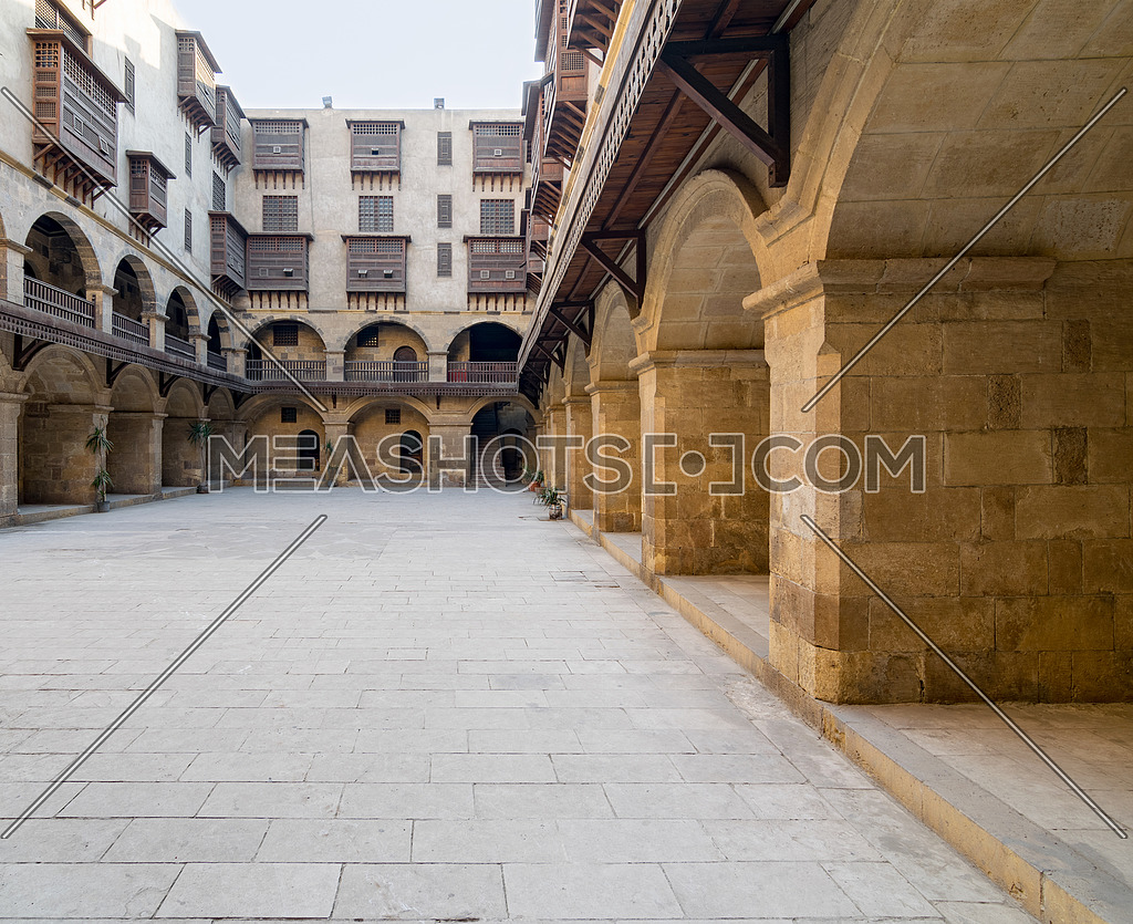 Facade of caravansary (Wikala) of Bazaraa, with vaulted arcades and windows covered by interleaved wooden grids (mashrabiyya), Medieval Cairo, Egypt