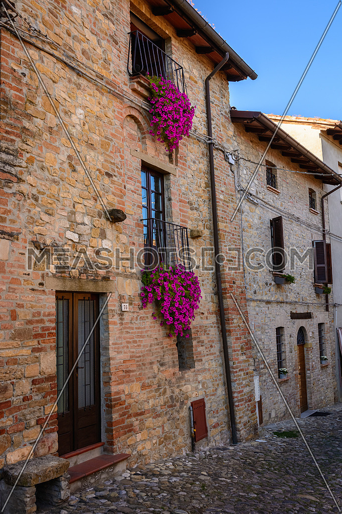 Beautiful vintage balcony with colorful flowers and stone wall medieval , Mediterranean style