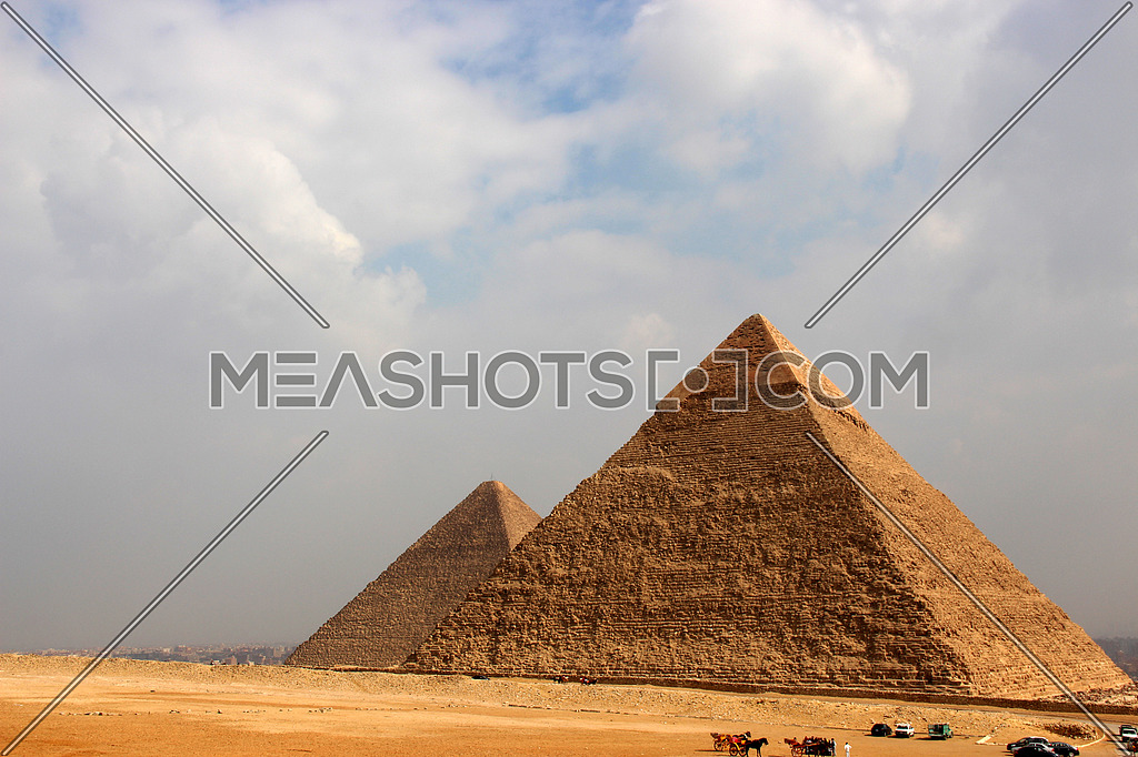 a photo showing the great & middle pyramid build in Giza during the pharaohs ancient civilization and the architecture style