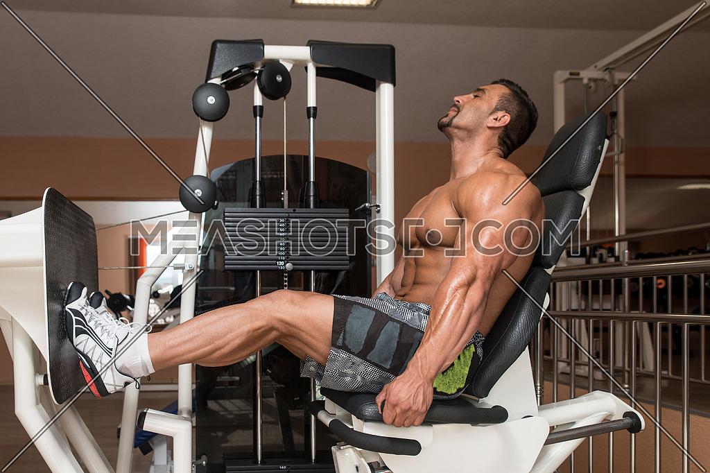 Bodybuilder Doing Heavy Weight Exercise For Legs