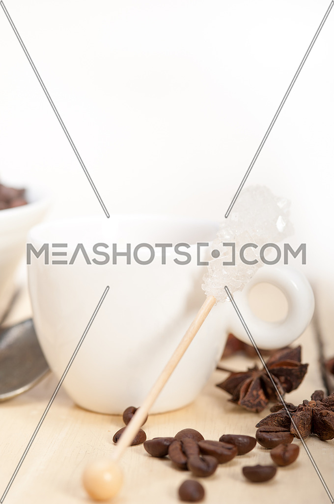 espresso coffee over white wood rustic table with sugar and spice
