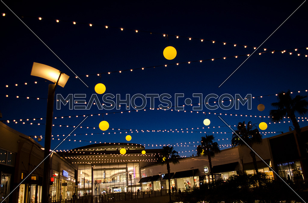 a night look of a mall with surrounded by lights