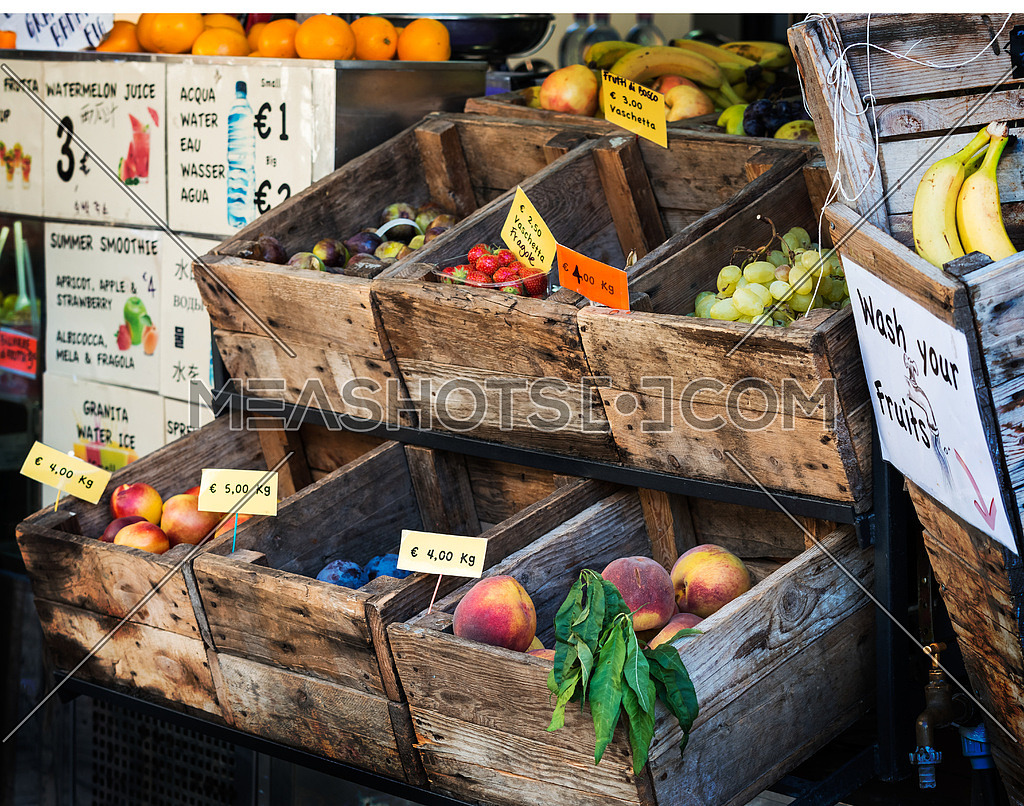 In the photo an old fruit shop in the center of Florence, where the fruit is exposed still in old wooden crates
