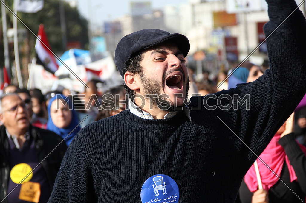a man chanting in a protest march