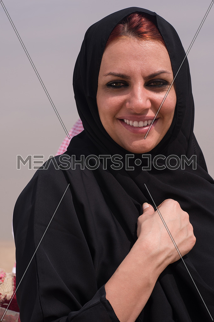 portrait of an egyptian woman in traditional clothes at great giza pyramids