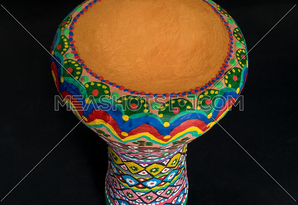 High angle of a colorful painted goblet drum (also chalice drum, tarabuka, darbuka, debuka, doumbek, dumbec, dumbeg, dumbelek, toumperleki, or tablah)