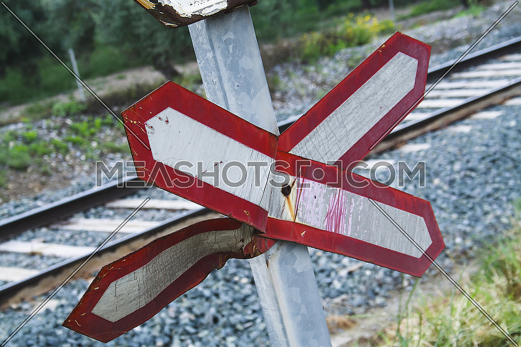 Warning sign worn of level crossing without barriers, blue sky with clouds