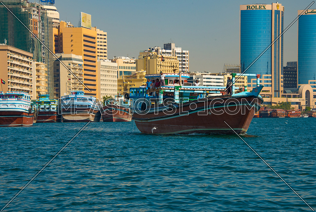 merchant ship sailing in the dubai creek