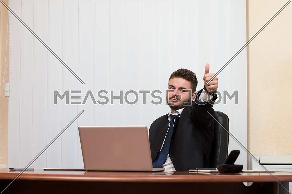 Happy Smiling Cheerful Business Man With Thumbs Up Gesture