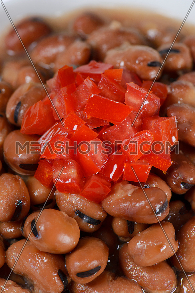 Medames beans, Egyptian oriental dish with tomato diced on top