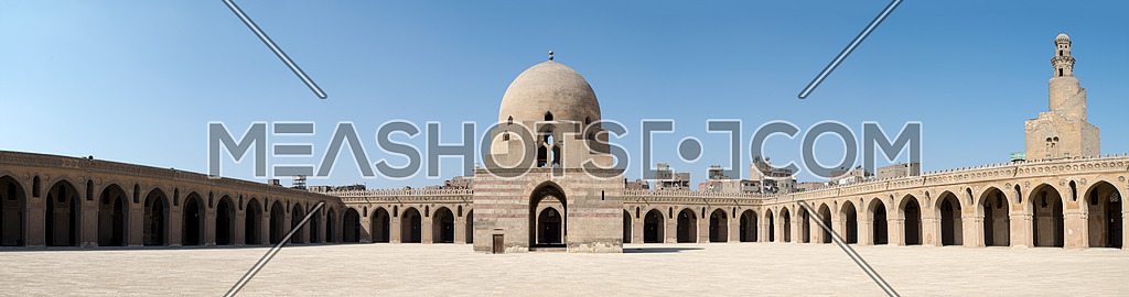 Panorama of the courtyard of Ibn Tulun Mosque, Cairo, Egypt, featuring the ablution fountain and the minaret. The largest one in Cairo, and the oldest one in the city with its original form