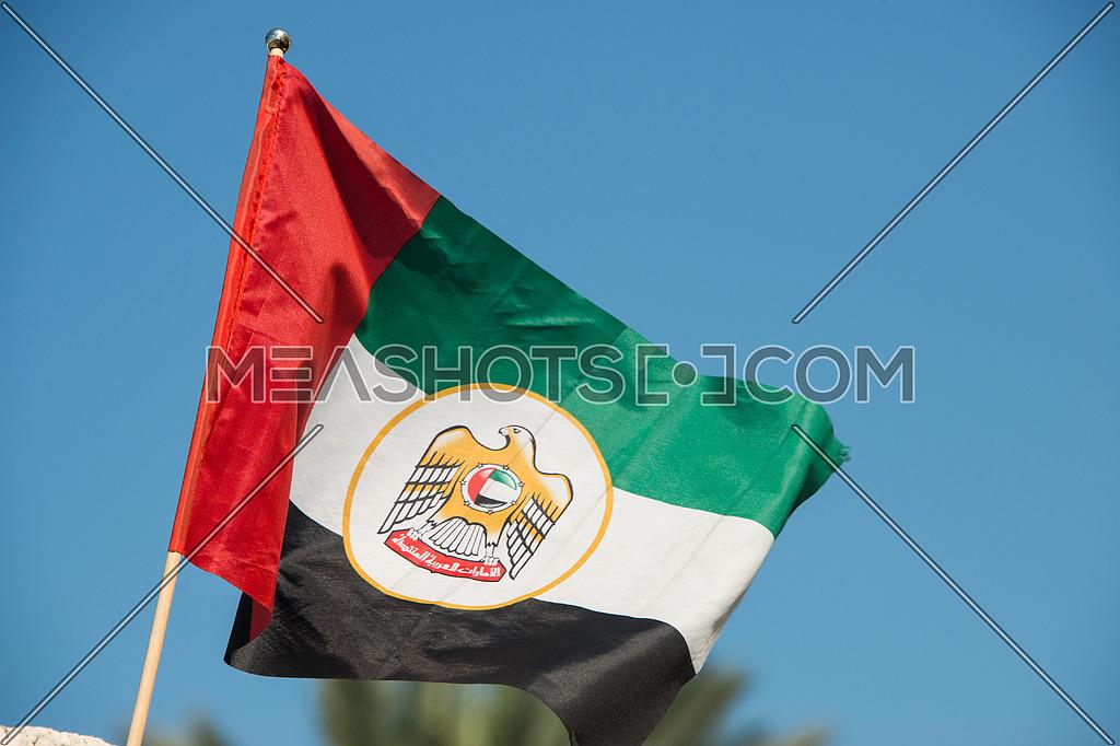United arab emirates flag against blue sky