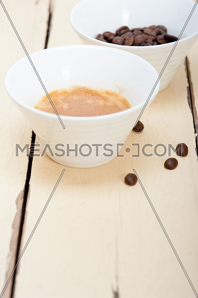 italian espresso cofee and beans on a white wood table
