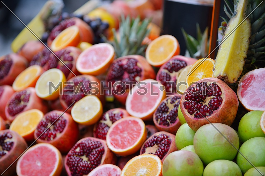 Colorful display of fruits background on traditional local market ready to made fresh juice drink