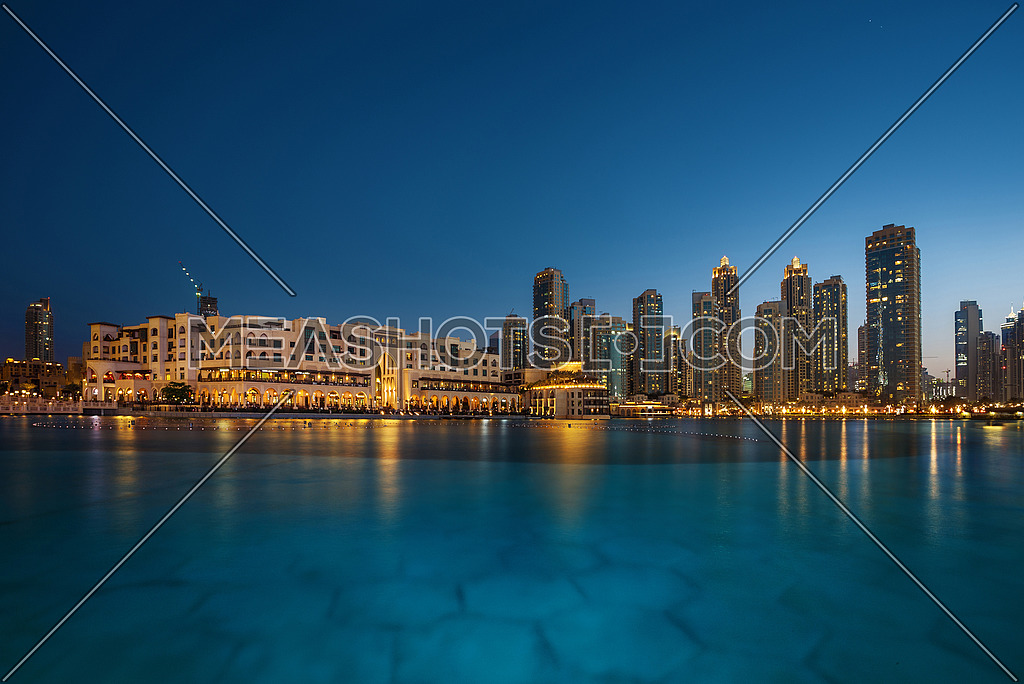 Dubai Souq Al Bahar in the downtown with beautiful reflections on water during the sunset
