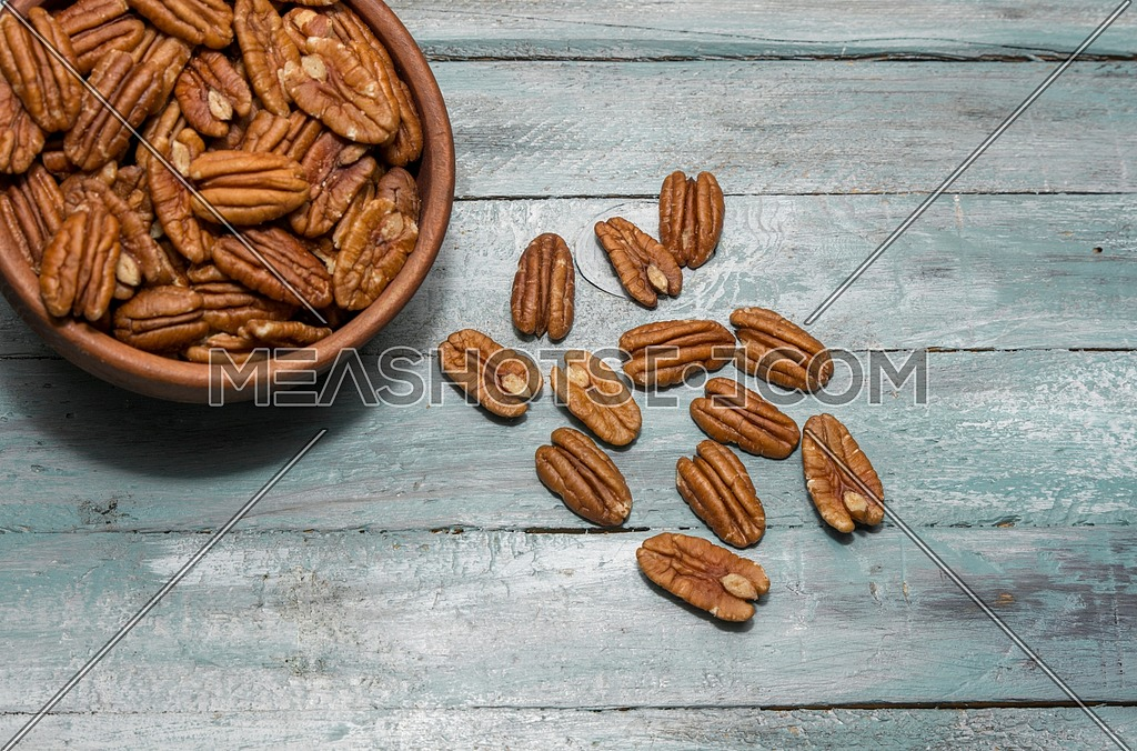 Pecan nuts on wooden background. Healthy food
