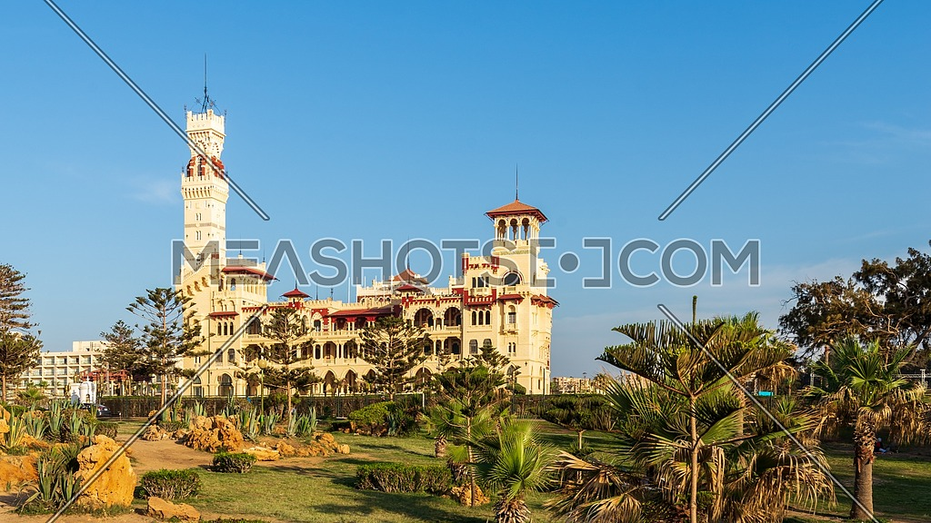 Day shot of Montaza public park with Royal palace and Palestine Hotel at far end, Alexandria, Egypt