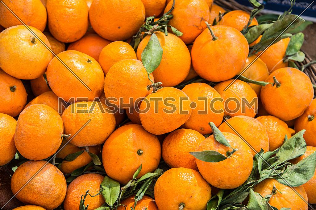 tangerine fruit in a basket