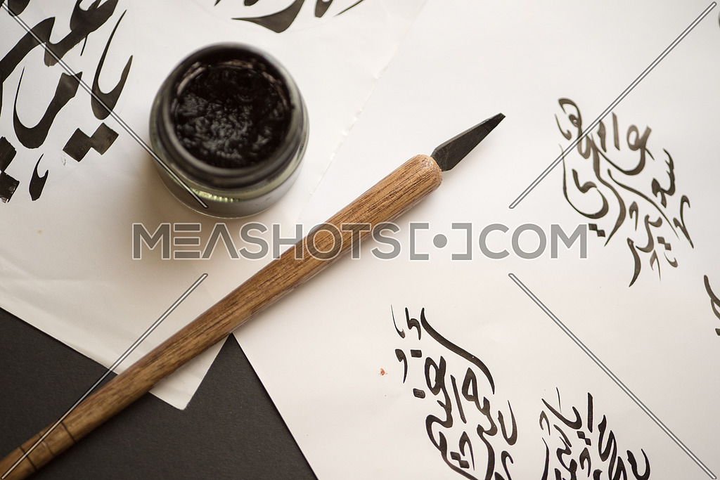 Arabic Calligraphy handwriting with ink and wooden pen