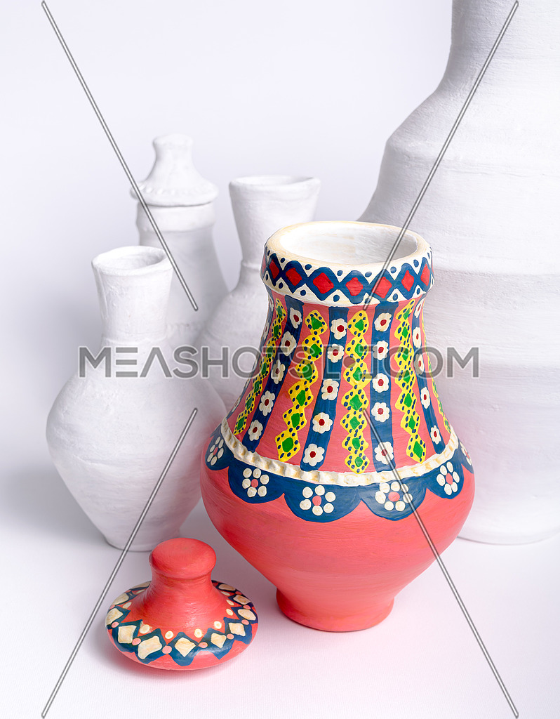 Egyptian decorated colorful pottery vase on background of white