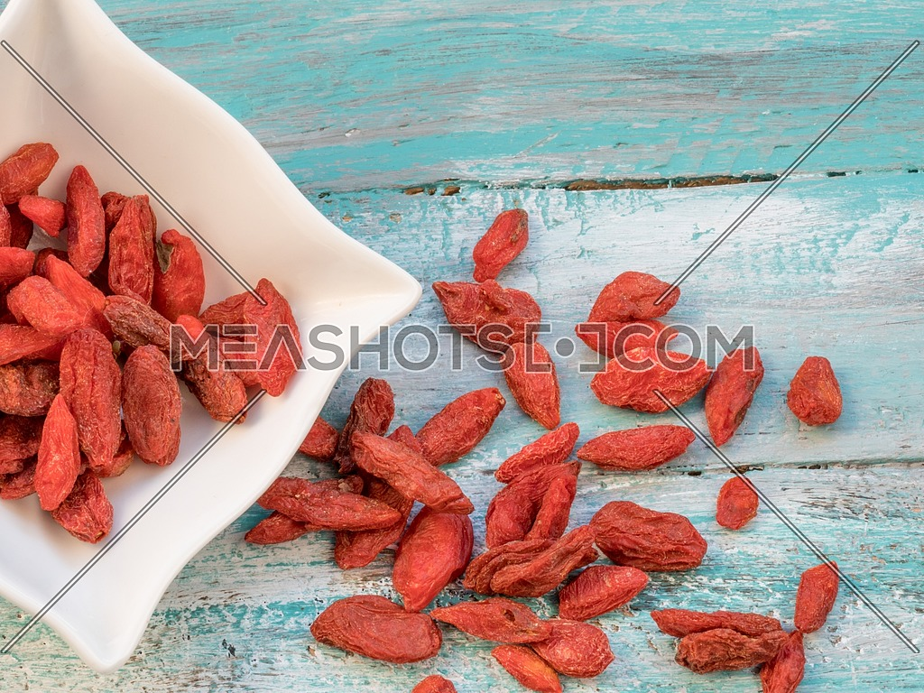 Goji fruits for health .Goji berries on a wooden background. (Lycium barbarum