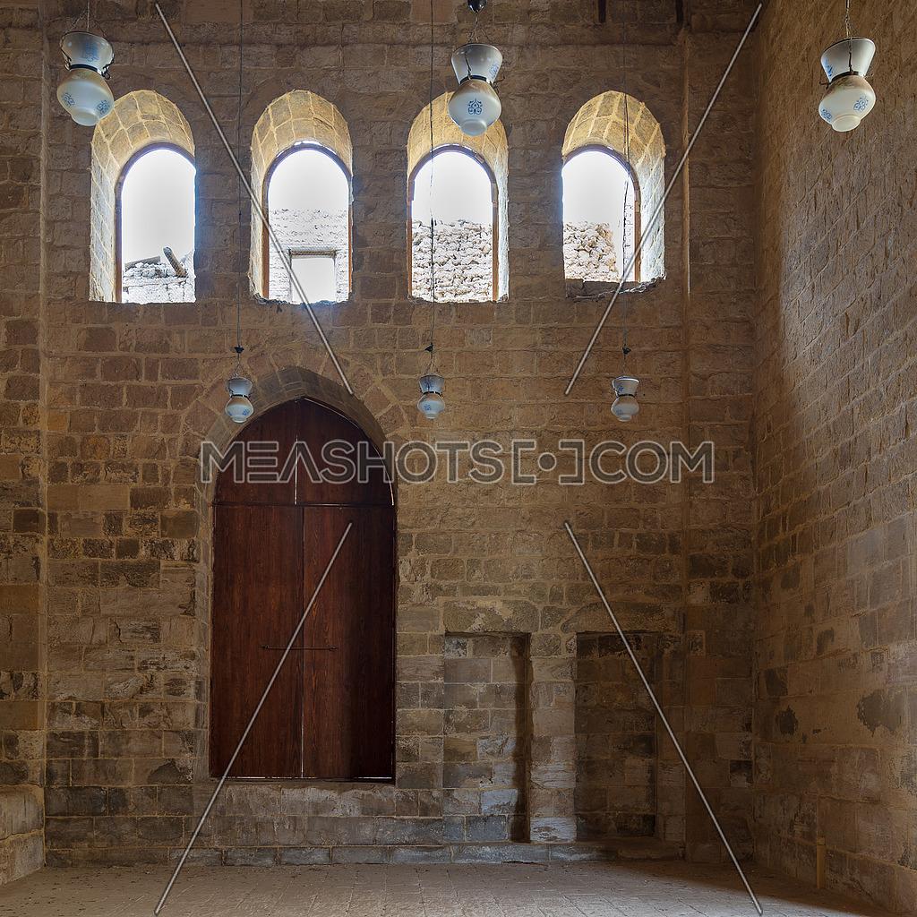 Public Mosque attached to Al-Muayyedi Bimaristan historic building, with wooden door and bricks stone wall, Darb Al Labana district, Old Cairo, Egypt