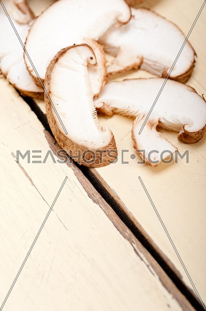 fresh shiitake mushrooms on a rustic wood table