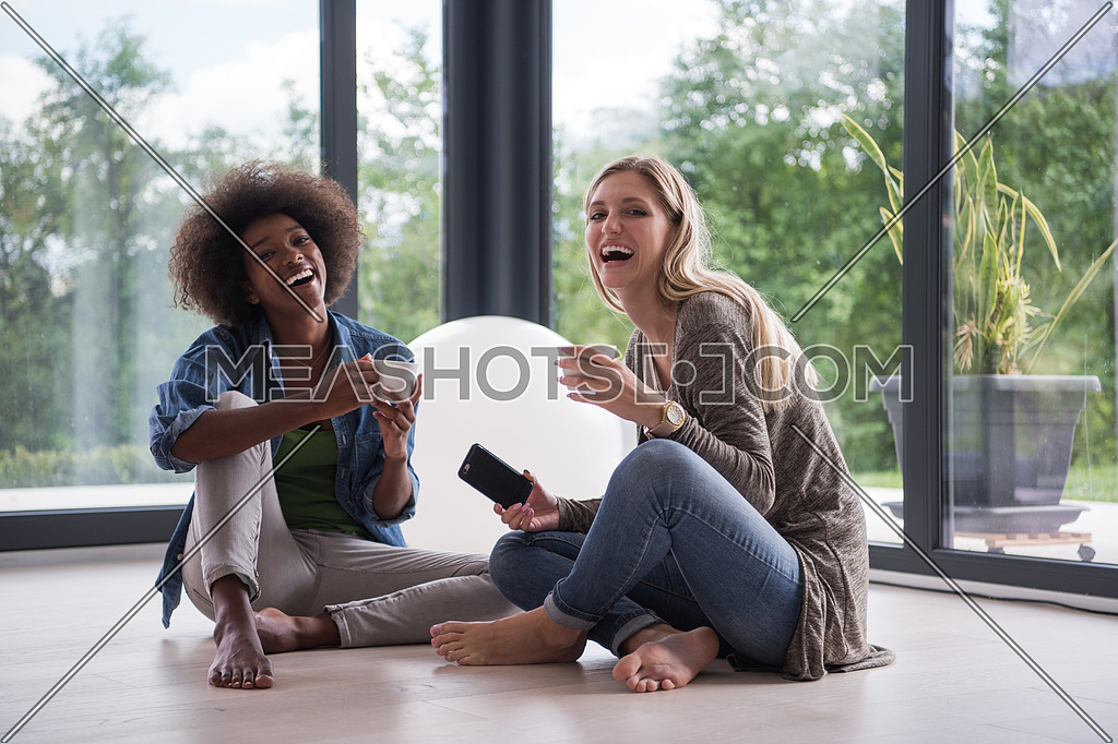 multiethnic women sit on the floor and