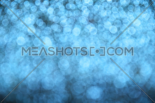 Winter blue glitter bright magic fairy light circles christmas abstract blur effect background