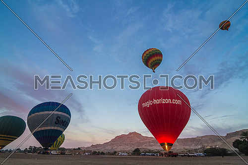 Low Angel shot for Hot Air Ballons take off in Luxor