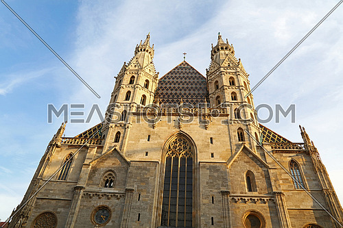 St Stephen Cathedral (Stephansdom) at Stephansplatz, the biggest cathedral and most important religious building in Vienna, Austria, over day blue sky, low angle front view