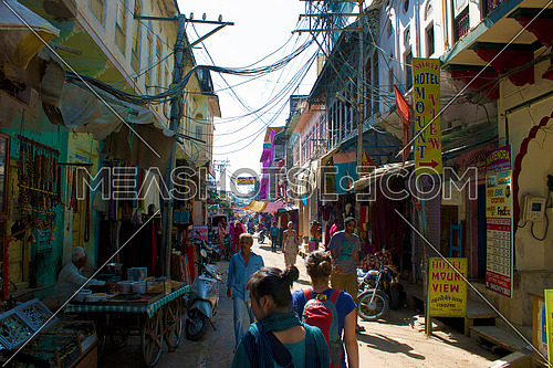 Tourists walking in a street market in pushkar India