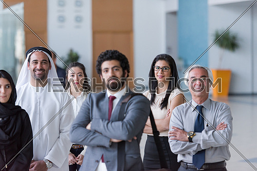 multi ethnic  business people group as team  on meeting at modern  office