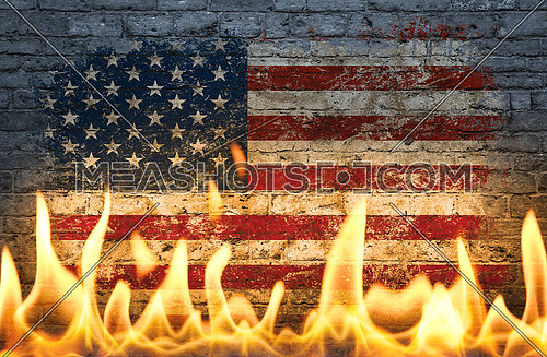 Close up wall with painted US American flag in flames as symbol of world on fire, danger, political, economic crisis or pandemic