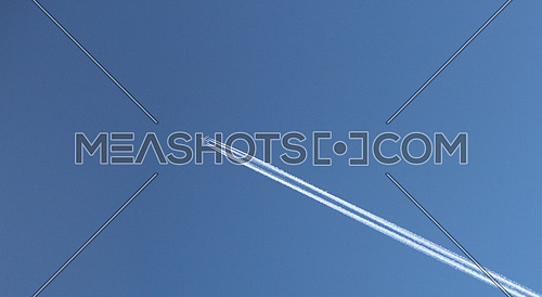 Emirates A380 plane flying at cruise altitude with white contrails on 12 Jan 2015