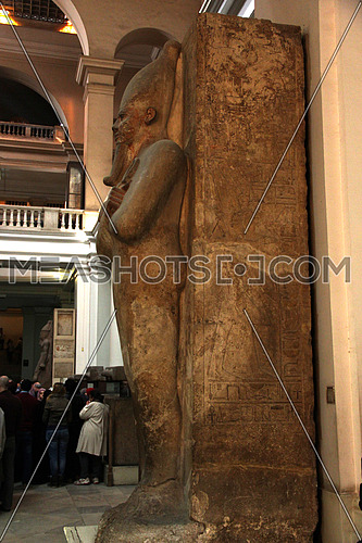 a photo from inside the Egyptian museum showing display of ancient statue built during the pharaohs civilization