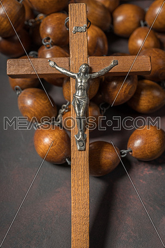 Big wooden Rosary beads and crucifix cross with jesus, spiritual atmosphere ,religion concept.