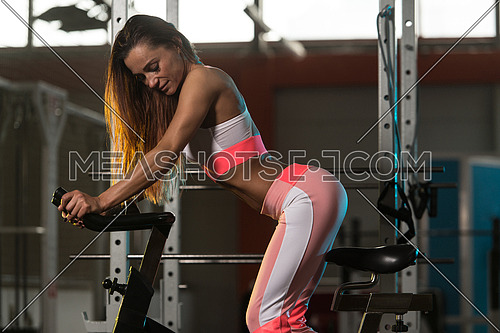 Woman In The Gym - Exercising Her Legs Doing Cardio Training On Bicycle