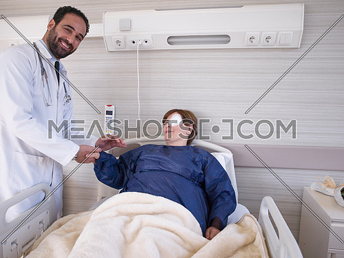 doctors and happy patient at eye clinic