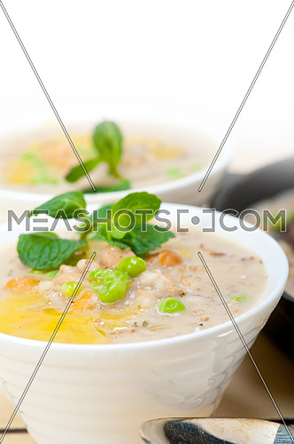 Hearty Middle Eastern Chickpea and Barley Soup with mint leaves on top