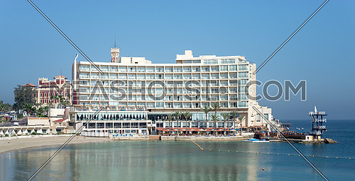Alexandria, Egypt - April 29 2018: Front view of Helnan Palestine Hotel from the sea with clear sky on a summer day, an old hotel located in Al Montazah Park