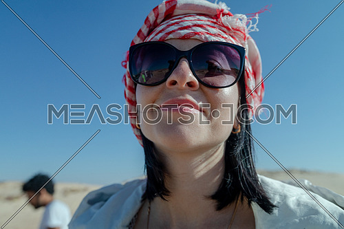 Close up for female tourist exploring Sinai Trail from Ain Hodouda at day.