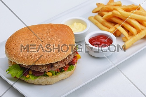 still life with fast food hamburger menu, french fries, soft drink and ketchup