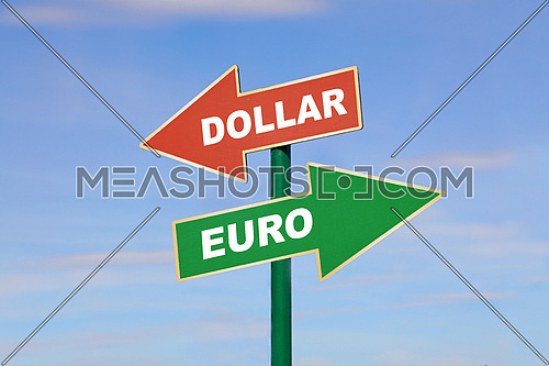 Road signpost with two different directions arrows, left and right, green Euro word up and red dollar down, over clear blue sky, low angle side view