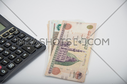black calculator and egyptian money