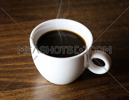 White cup of dark espresso coffee
