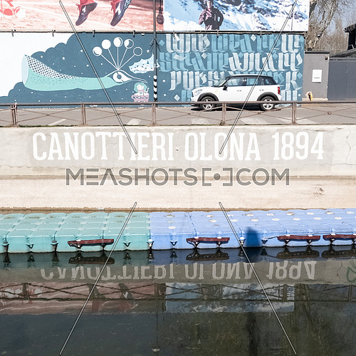 """Written on wall """"Canottieri Olona 1894"""" (Rowers Olona from 1894) on the Naviglio Milanese canal near the headquarters of the Olona rowers.Milan,Italy."""