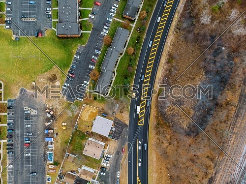 Cars from the height. Aerial view of the road trees and houses